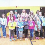 Girl Scouts compete in pinewood derby