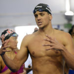 US-Australia rivalry highlights 1st night in Olympic pool