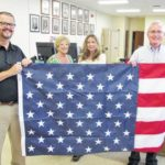 Flag presented to Register of Deeds for 'Thank a Veteran' program