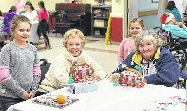 Girl Scouts Bring Christmas Crafts To Nursing Home Residents