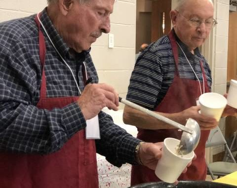 Volunteers dish up hot bowls of homemade soup at the 2020 Empty Bowls fundraiser held just before a statewide stay-at-home order began due to the COVID-19 pandemic.                                  File photo