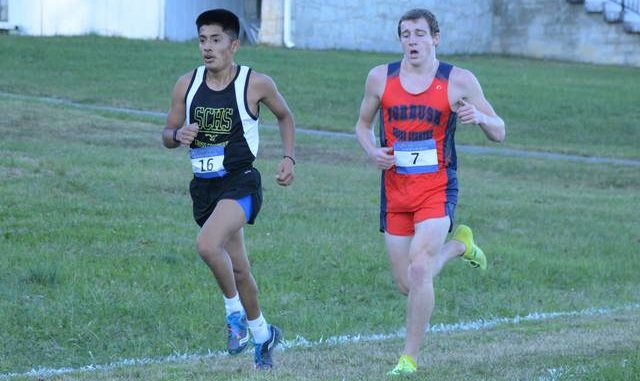 Surry Central's Hector Morales, left, takes a slight lead against Forbush's Nate Warden near the end of Tuesday's race.                                  Cory Smith | The News