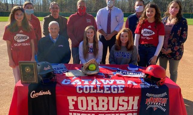 Forbush softball player, Salem Finney, signed her National Letter of Intent to play softball at Catawba College in 2021. Finney has been a standout player for the Lady Falcons since Sophomore year. She was named the Western Piedmont Pitcher of the Year in 2019-2018, and earned All Conference honors. Her Junior season was cut short due to COVID, but Finney played travel ball over the summer and earned several home runs and strikeouts per game. Finney was joined at the signing by, front row from left, Tatum Finney, Lee Finney, Salem Finney, Rhonda Finney, and Arden Finney. Back row, assistant softball coach Natalie Vestal, Jimmy Warden, Forbush head softball coach Jeremy Helton, Forbush Principal Denny Key, Forbush Athletic Director Matt Pruitt, and assistant softball coach Jamie Sloan.                                  Kristian Russell | Yadkin Ripple