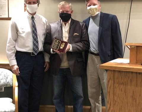 County Chairman Kevin Austin (left) and Executive Director of the Piedmont Triad Regional Council Matthew Dolge (right) present the Grady Hunter Award to Wayne Moore.