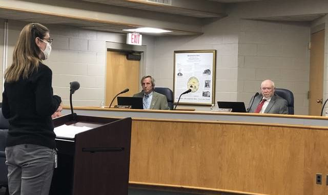 Yadkin County Assistant Human Services Director Jessica Wall gives an update on COVID-19 at the Yadkin County Board of Commissioners meeting.