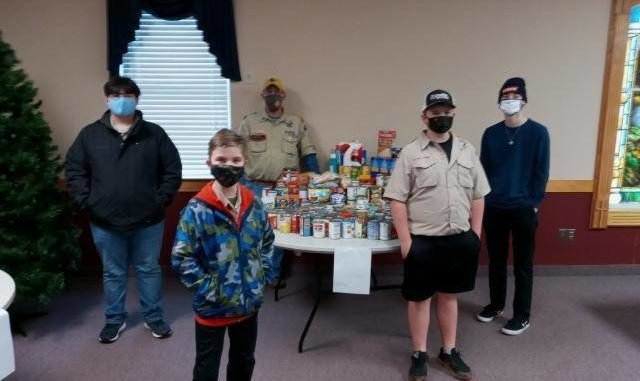 Area Boy Scouts collect food for Tri-C and Yadkin Christian Ministries.
