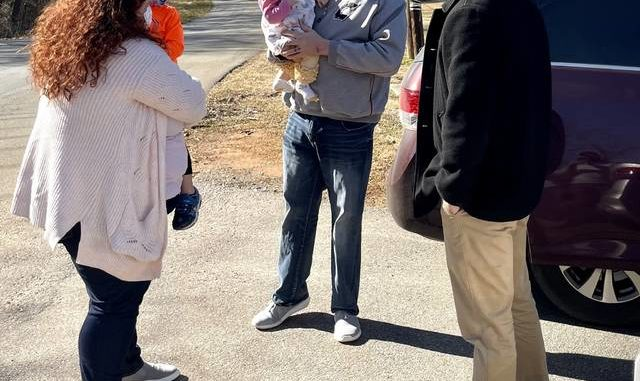 Senate candidate Jeff Jackson speaks with Yadkin County residents during a tour of the area on Sunday.