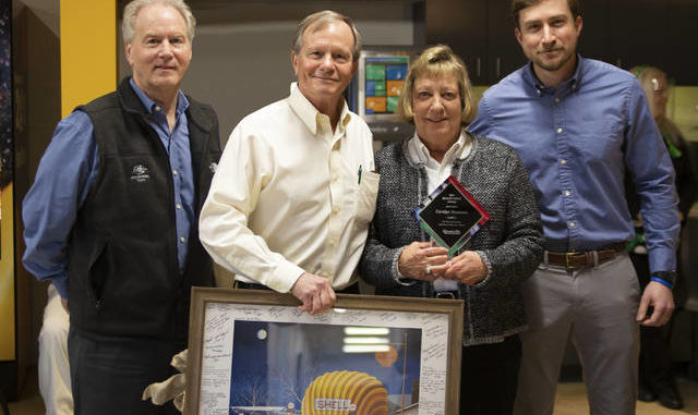 Carolyn Simmons is presented with the Spirit Award from Quality Oil Company.