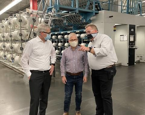 Congressman Patrick McHenry (center) tours the Unifi REPREVE Recycling Center in Yadkinville on Monday with Unifi CEO Eddie Ingle (left) and Polyester Plant Operator Barry Shore (right), who has been with Unifi for 43 years.