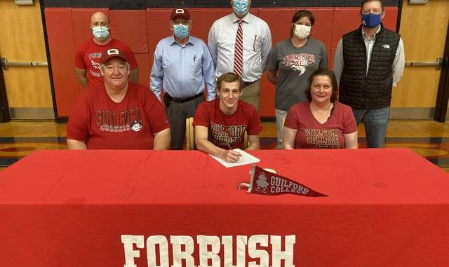 Last week, Forbush athlete Nate Warden signed his National Letter of Intent to run cross country and participate as a track and field athlete at Guilford College. Warden was joined at the signing by, front row from left, Johnny Warden, Nate Warden, and Angela Warden. Back row, coach Nathan Handy, Lawrence Warden, Forbush Principal Denny Key, coach Stephanie Beuter, and Athletic Director Matt Pruitt.                                  Kristian Russell | Yadkin Ripple