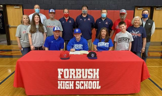 Forbush baseball player, Peyton Wall, signed his National Letter of intent to play baseball at Surry Community College. Joining Peyton at his signing were, front row, Kiersten Wall, Eric Wall, Peyton Wall, Andrea Wall, and Bryson Wall. Second row, Sharon Wall, Curtis Wall, Dana Spillman, and Kathy Spillman. Back row, Principal Denny Key, Coach Jeff Weisner, Coach Jack Moss, Coach Will Bell, and Athletic Director Matt Pruitt.                                  Kristian Russell | Yadkin Ripple