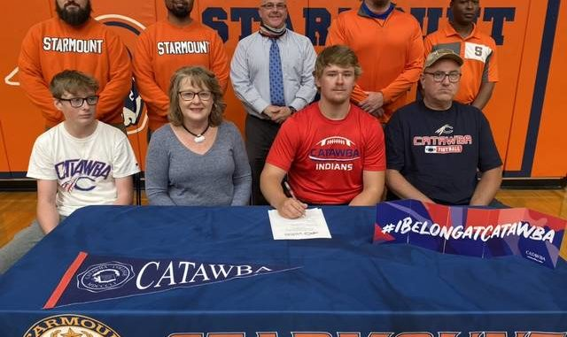 On Monday afternoon Starmount football player, Denver Stokes, signed his National Letter of Intent to play football at Catawba College. Stokes was a 6'4 defensive lineman for the Rams. He was named All Conference for his junior and senior years. Joining Stokes at the signing were, front row from left, Houston Stokes, Julia Stokes, Denver Stokes, and Mark Stokes. Back row, coach Cole Patterson, coach Kris Allen, Principal Tracy Kimmer, coach Chris Brown, and head football coach Sandy Grinton.                                  Kristian Russell   Yadkin Ripple