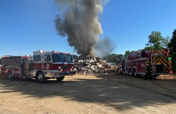 Yadkinville Fire Fighters on the site of a large scrap metal fire on Thursday afternoon.