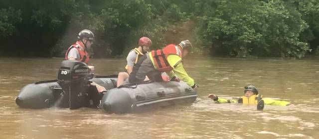 Boat crew members make contact and prepare for a moving water rescue of Jeff Taylor from the Yadkin County Rescue Squad during a training event held Saturday.