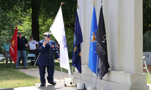 World War II veteran Jim Gant, a U.S. Coast Guard Electrician's Mate First Class, participates in the posting of service colors during the Memorial Day service at Yadkin County Park.                                  Lisa Michals | The Yadkin Ripple