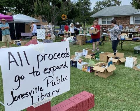 The Friends of the Jonesville Library group donated proceeds from their U.S. 21 Road Market yard sale toward the expansion of the Jonesville library.                                  Lisa Michals | The Tribune