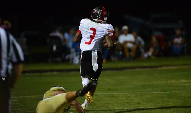 East Wilkes' Anthony Graham (3) torched Surry Central with 243 yards rushing and three touchdowns.                                  Charles Leftwich   Special to the News