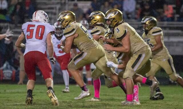 Luke Hurley (50) moves in to make a tackle for the Falcons on Friday night.                                  Cory Smith | Yadkin Ripple